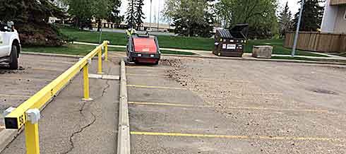 Parking lot sweeping in progress